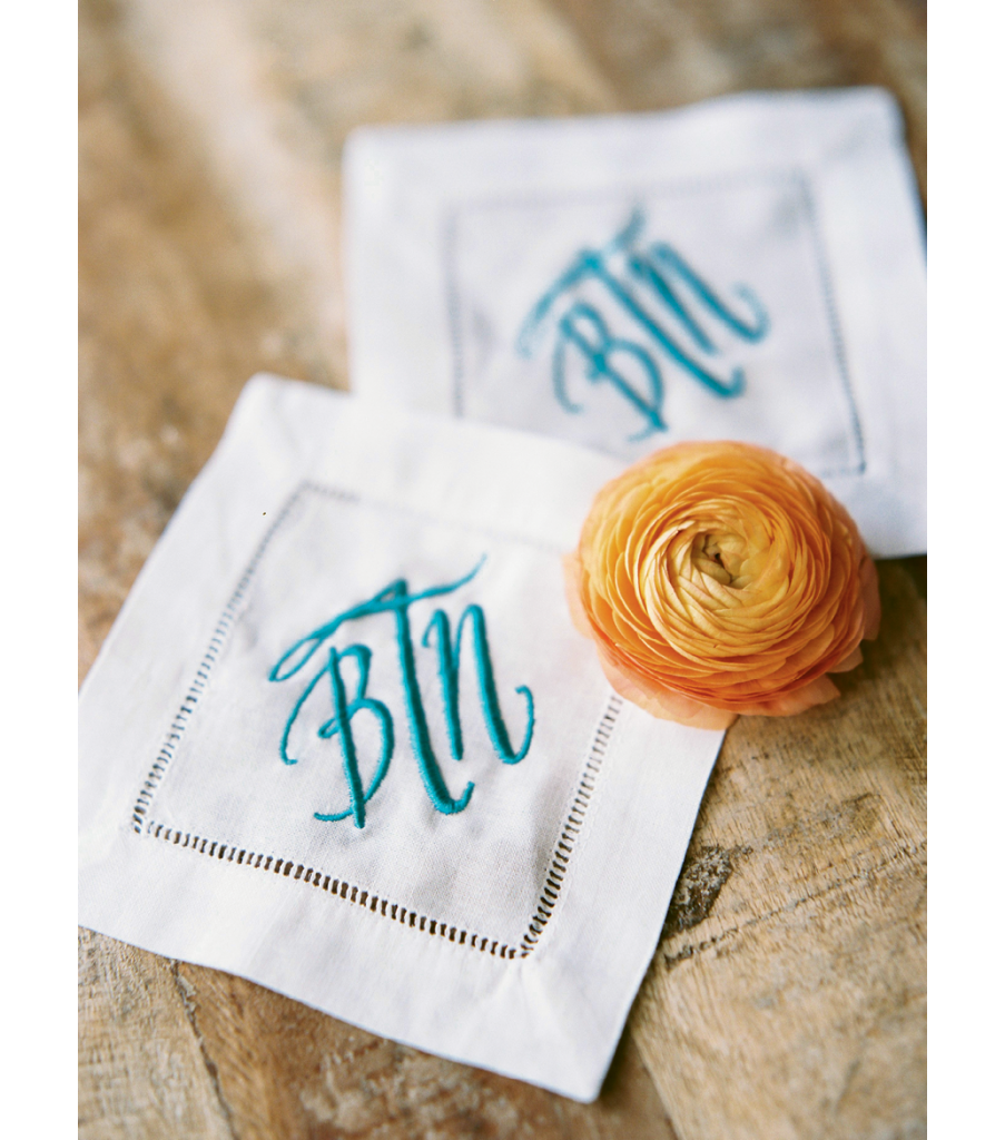 Smaller events can allow for splurges, like these monogrammed cocktail napkins the couple now uses at home. Image by Perry Vaile Photography.