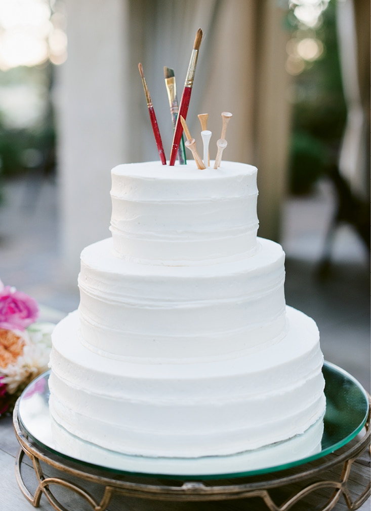"""As a nod to the couple's professions, paintbrushes and golf tees topped the dessert. """"We cleaned them thoroughly before sticking them in the cake!"""" laughs Teil. (Image by Natalie Franke Photography)"""