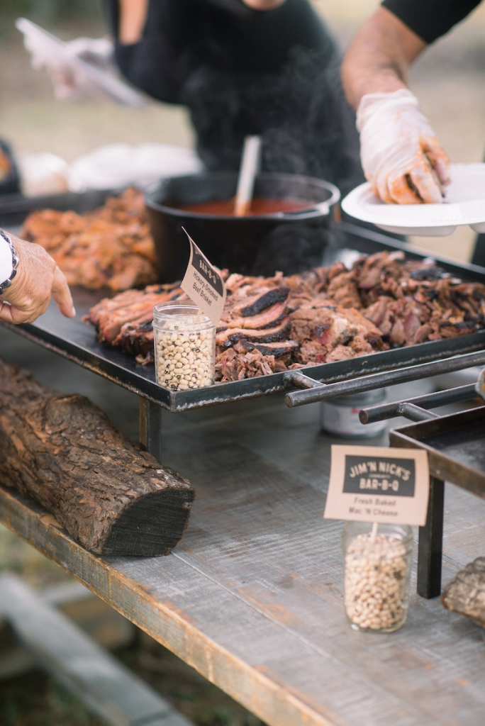 When hiring a caterer, ask  about their setup. Some are all  about Instagram-worthy iron skillets, mobile smokers, oyster roast tables, and Mason jar treats. Others are more about plastic utensil and tin warming trays. Either works  depending on your vision—and your budget. (Photo by Tim Will)