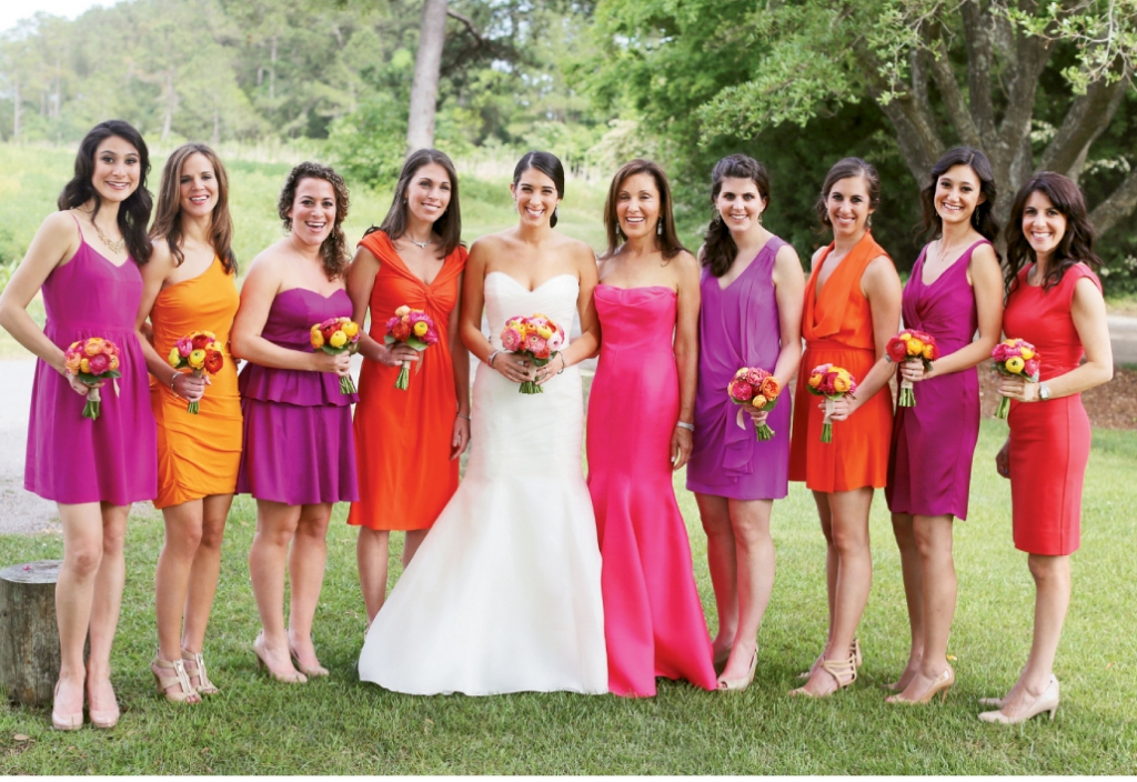 "DAZZLING DAMES: Pearlann gave attendants, the maid of honor, and her mother one directive when it came to their frocks: ""I asked them to choose a warm, bright color,"" she says. ""And it worked! I loved the look."" As for the bride?  She was radiant in a gown by Rivini."