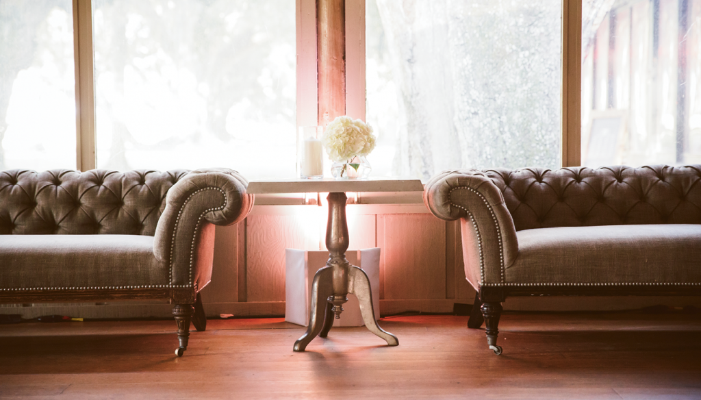 Comfy sofas from  Snyder Events offered guests respite from the lively dance floor.   <i>Amelia + Dan Photography</i>