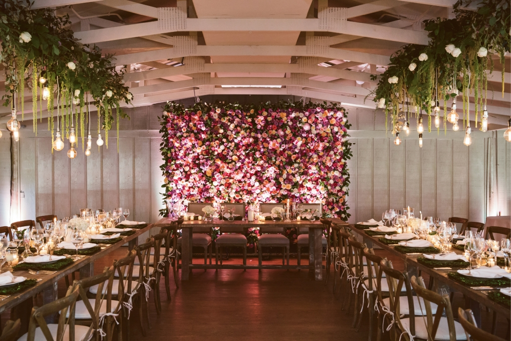Christina worked with Petaloso to recreate Middleton's majestic gardens inside the site's Pavilion hall. The focal point? An eight-by-10-foot floral wall of roses and peonies that marked the head table.  <i>Amelia + Dan Photography</i>