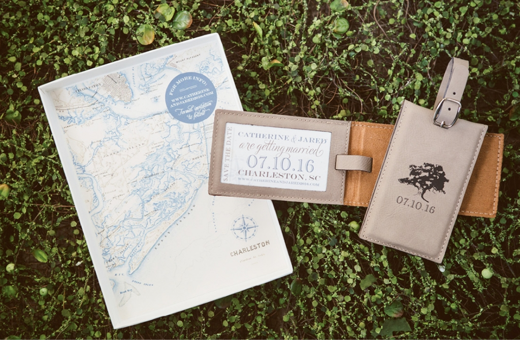 With most guests traveling from afar, custom leather luggage tag save-the-dates engraved with an oak tree silhouette—a nod to the ceremony site—set the scene for the destination wedding.  <i>Amelia + Dan Photography</i>