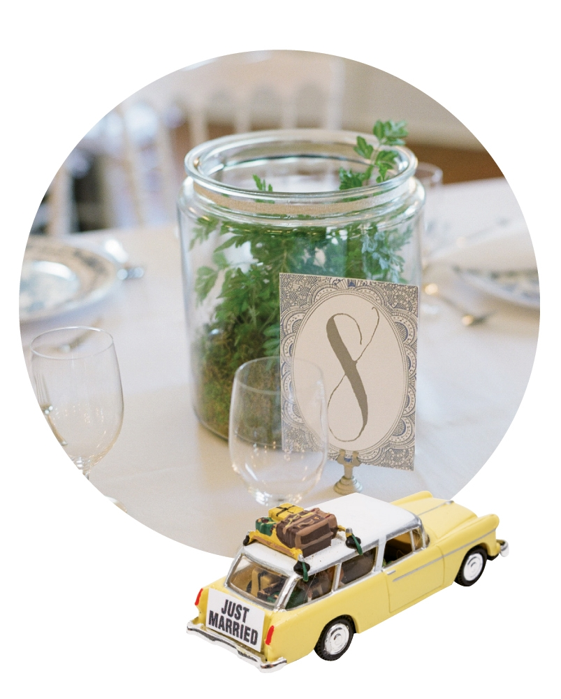 Centerpiece terrariums made by friend (and master gardener) Joan McDonald featured comical and sentimental figurines that told little life stories. (There was one with graded papers for Wade and a mini version of Charleston Weddings with a tea cup in another for me).