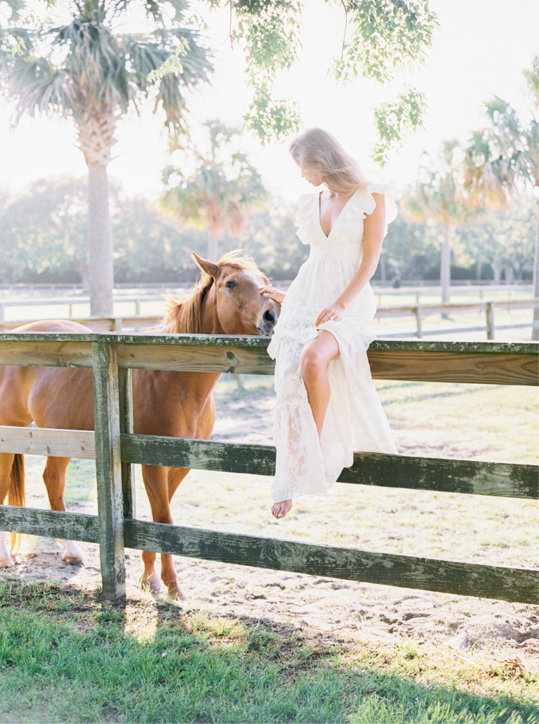 Rachel Zoe's silk and cotton fil coupé tiered V-neck dress with ruffled sleeves from MODELBRIDE.  Morganite and  diamond rose gold ring from Gold Creations. Location: Seabrook Island Club Equestrian Center.  Photograph by Perry Vaile