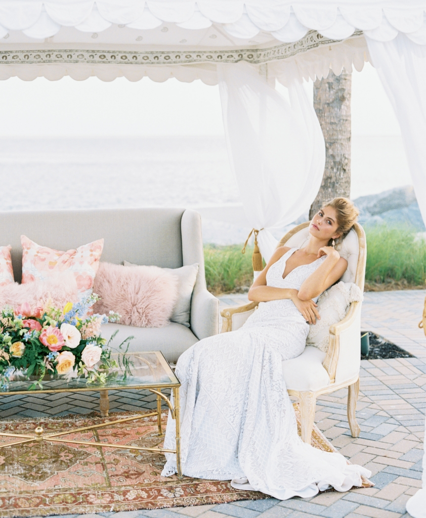 """Mariposa"" gown from Kate McDonald Bridal. Kendra Scott earrings from Bella Bridesmaids. Tent and lounge from Out of Hand. Florals by Out of the Garden. Location: Seabrook Island Club, Ocean Terrace. Note: Sea Island residents, club members, and off-island couples can rent the Seabrook Island Club Ocean Terrace for ceremonies. Photograph by Perry Vaile"
