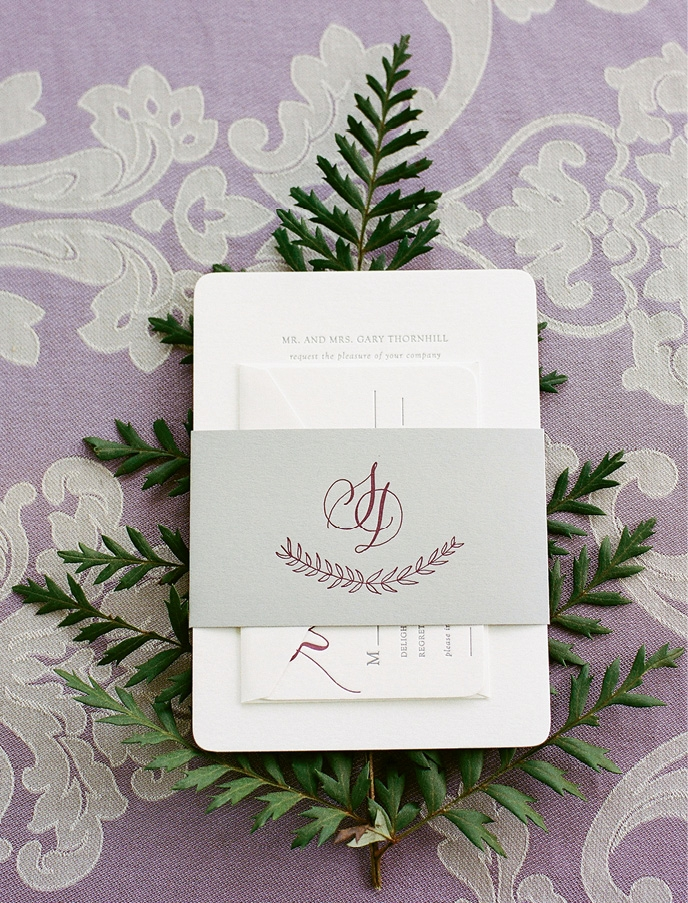 A single purple branch on the invitation conveyed the garden theme and set the palette.    <i>Photograph by Theo Milo</i>
