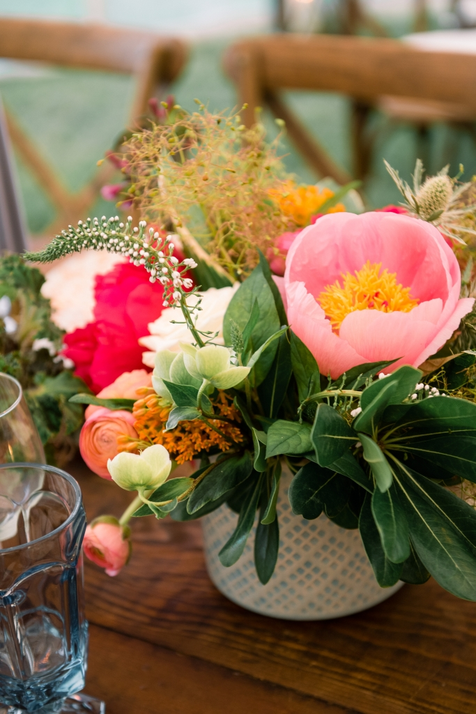 "Patterned vessels held colorful combinations of garden roses, hellebores, lysimachia, orchids, peonies, and ranunculus. Says florist Anne Bowen of Charleston Stems: ""Late spring brings so many options—the sky's the limit!"" <i>Image by Timwill Photography</i>"