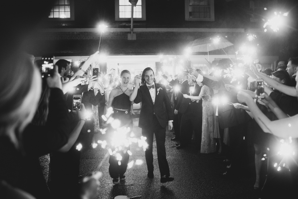 "A sparkler send-off is always in style, particularly on a holiday weekend like Memorial Day. Of her getaway ensemble, Jane says, ""I wanted something I could wear again, and black is much more my style than white."" <i>Image by Timwill Photography</i>"