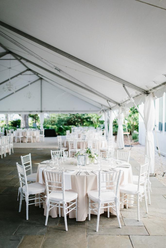 Wedding design by A. Caldwell Events. Florals by Tiger Lily Weddings. Rentals by EventWorks. Tent by Snyder Events. Image by Clay Austin Photography.