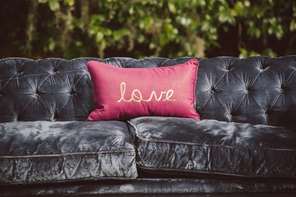 Easy Does It  Foil patterns with  solid elements like  this velvet sofa.  <i>Image by amelia + dan photography</i>