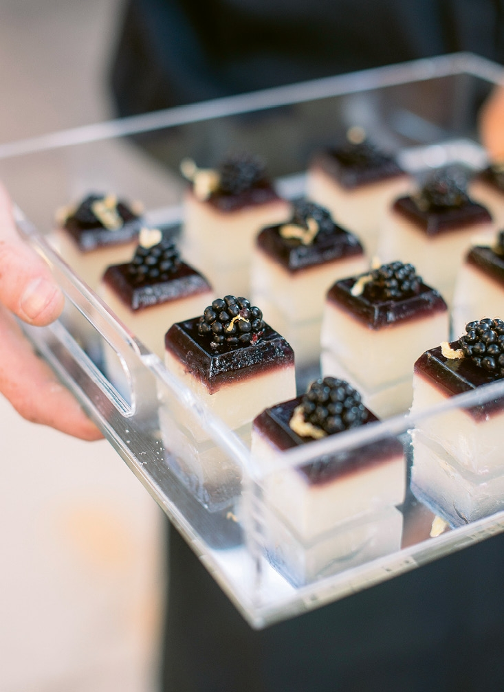 "Sometimes it's the smallest touches that are the most memorable, like these blackberry Jell-O shots. ""Guests were wowed by them!"" says planner Megan Chandler.  <i>Image Timwill Photography</i>"