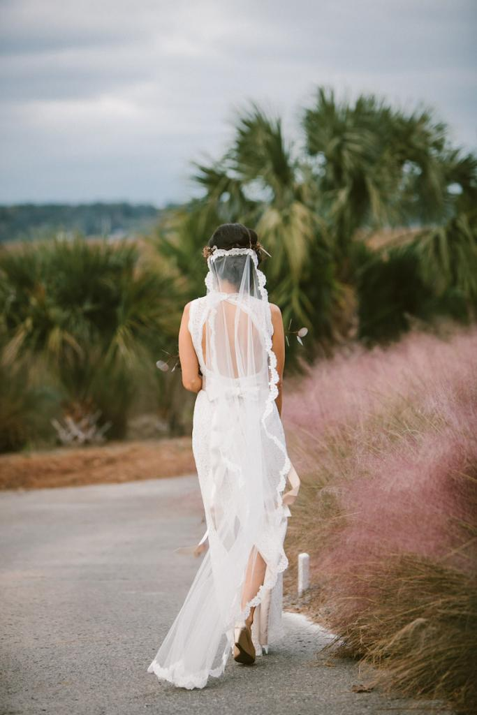 Bride's gown by Watters from Jean's Bridal. Veil from Bridal House of Charleston. Photograph by Mark Williams Studio at the Daniel Island Club.