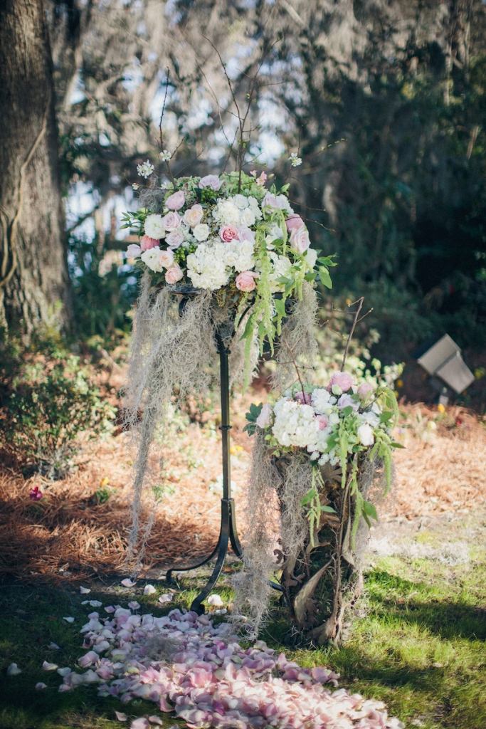 Wedding design by Engaging Events. Ceremony florals by Tiger Lily Weddings. Image by Richard Bell Weddings at Magnolia Plantation & Gardens.