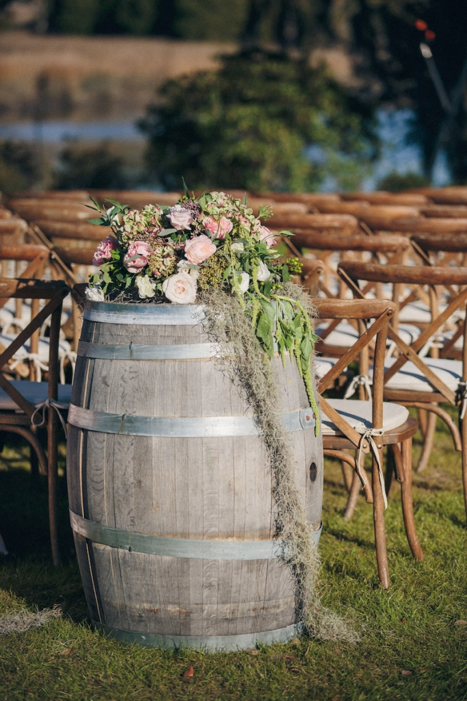 Ceremony florals by Tiger Lily Weddings. Wedding design by Engaging Events. Image by Richard Bell Weddings at Magnolia Plantation & Gardens.