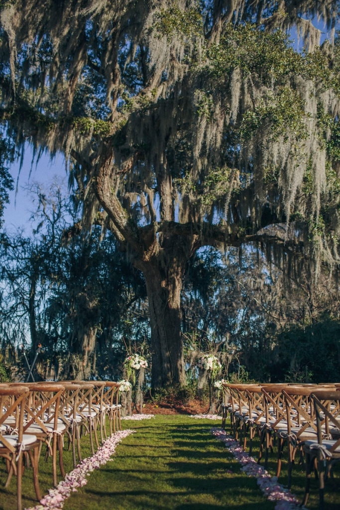 Ceremony florals by Tiger Lily Weddings. Wedding design by Engaging Events. Rentals by Snyder Events and EventWorks. Image by Richard Bell Weddings at Magnolia Plantation & Gardens.