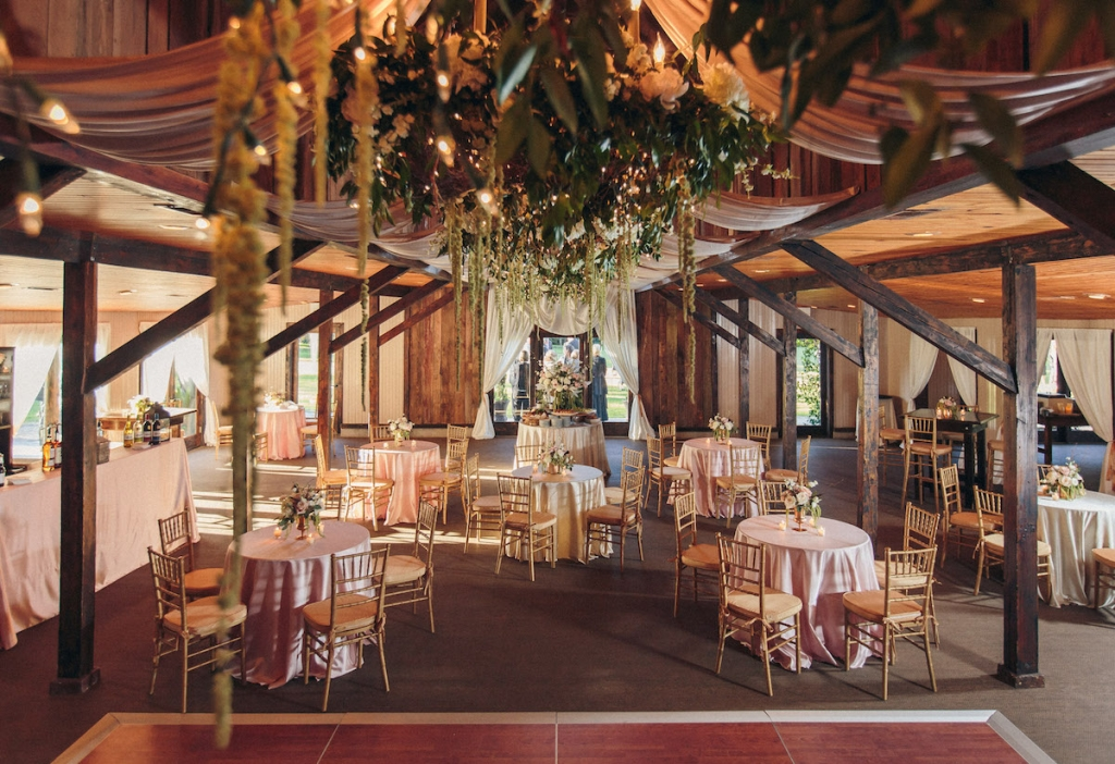 Wedding design and reception florals by Engaging Events. Image by Richard Bell Weddings at Magnolia Plantation & Gardens.