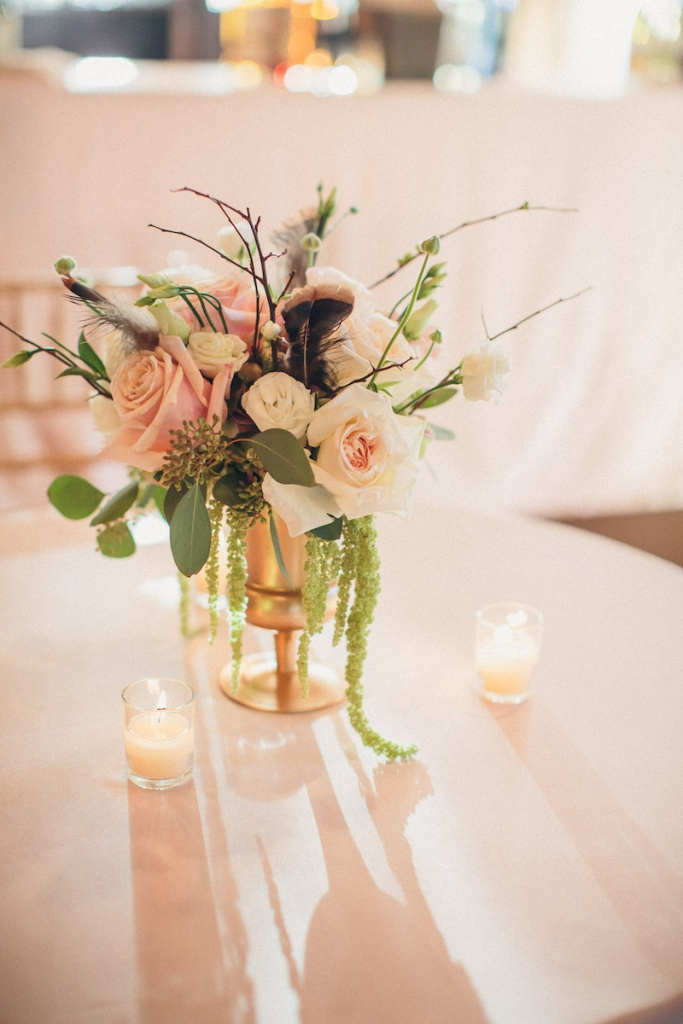 Reception florals by Engaging Events. Image by Richard Bell Weddings at Magnolia Plantation & Gardens.