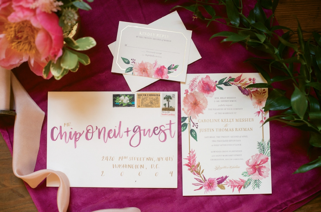 Studio R Designs painted a flower frame on the couple's gilded edge invitations, which J.Lily Designs addressed.