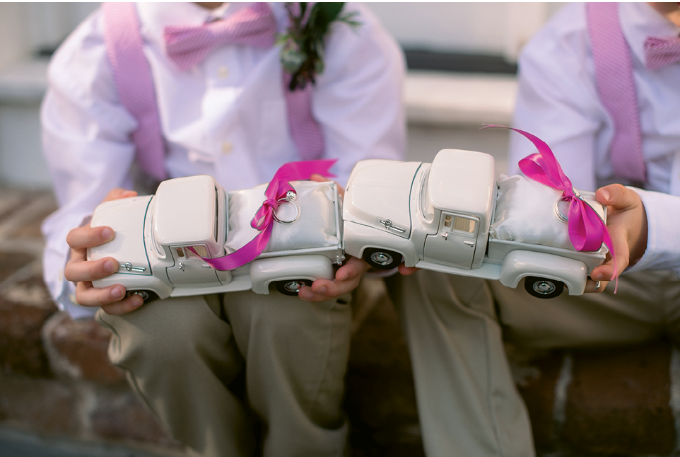 "As an incentive (read: bribe) for Justin's cousins to nail their ring bearer duties, Caroline plied them with vintage toy ""ring pillows"" she found on Etsy. It was perfect, she says, for the pair of ""little country boy truck lovers."""
