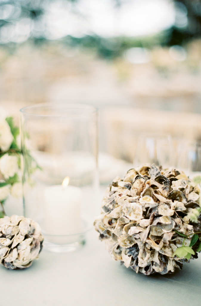 Oysters were a favorite element on the bride's inspiration boards, so globes like this dotted the setting