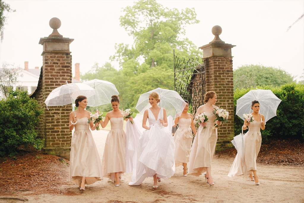 Transparent umbrellas kept Elisa and her maids dry—and oh-so fashionable.     <i>Image by Evan Laettner Photography</i>