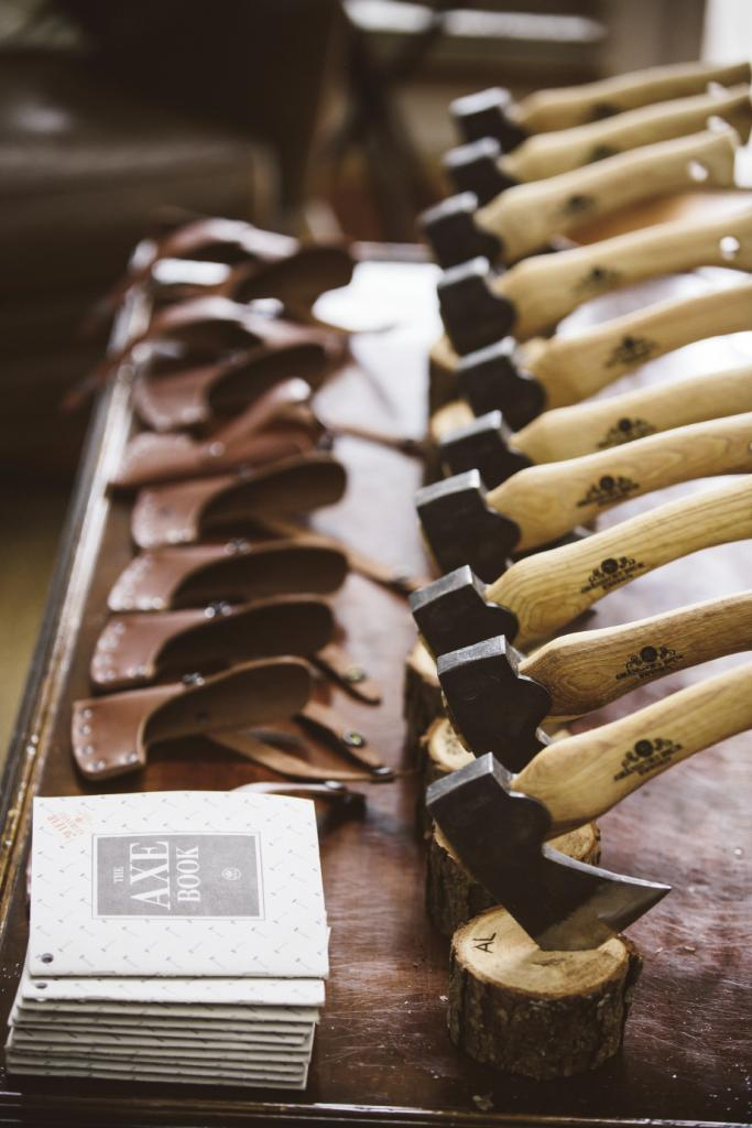 Kent gifted his  groomsmen hatchets; his father burned each of their names into the handles. Image by amelia + dan photography.