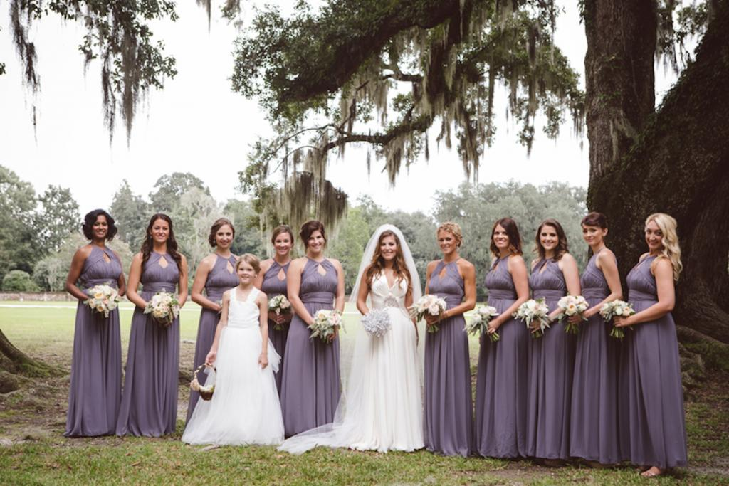 Bridesmaids' dresses from Jean's Bridal. Bride's gown by Jenny Packham from White on Daniel Island. Florals by Fox Events. Image by amelia + dan photography at Middleton Place.