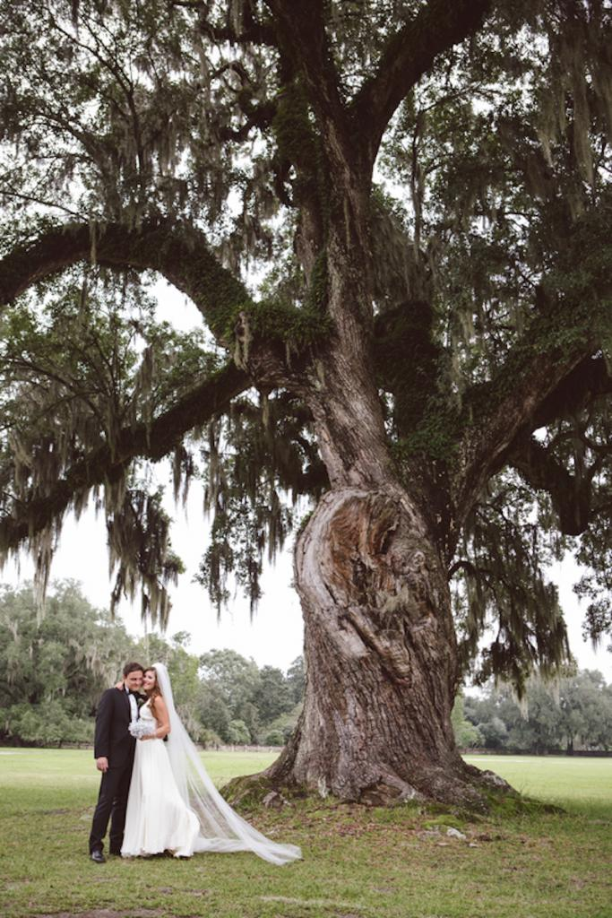Bride's gown by Jenny Packham from White on Daniel Island. Menswear from Charleston Tuxedo. Image by amelia + dan photography at Middleton Place.
