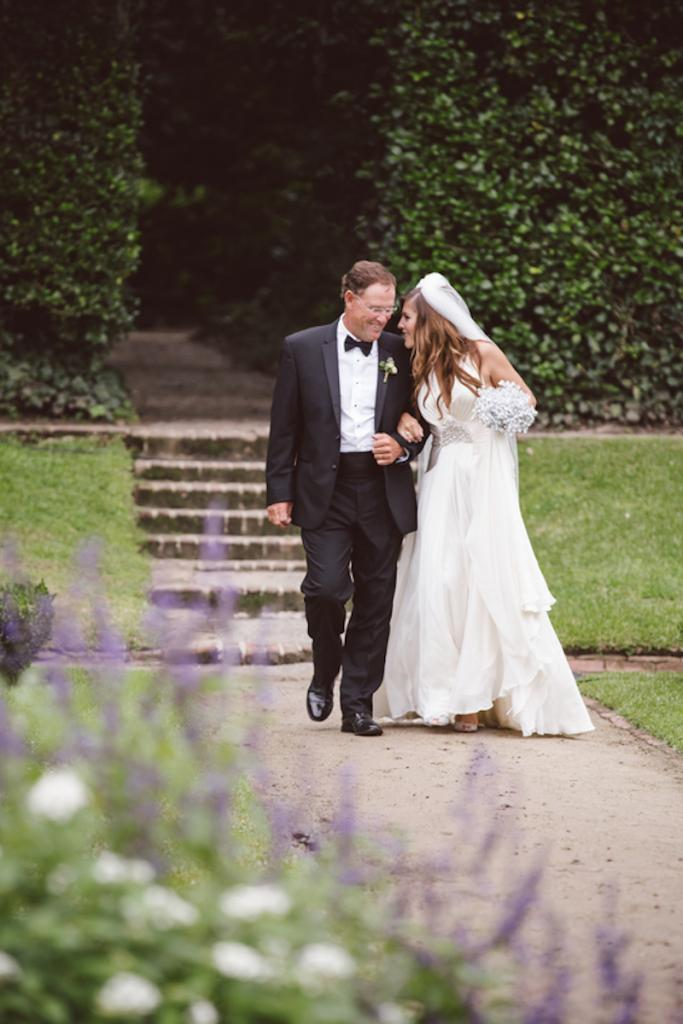 Bride's gown by Jenny Packham from White on Daniel Island. Bouquet from Bridal Bouquets by Ky (Etsy). Menswear from Charleston Tuxedo. Image by amelia + dan photography at Middleton Place.