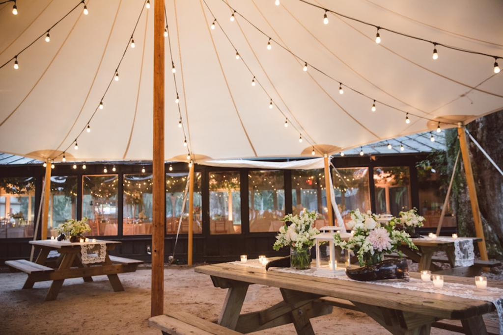 Tables from EventHaus. Tent by Sperry Tents Southeast.. Lighting by Innovative Event Services. Florals and wedding design by Fox Events. Image by amelia + dan photography.