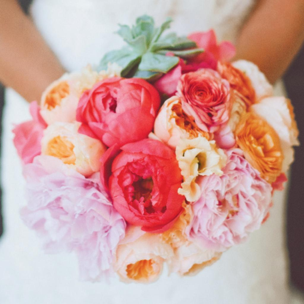 2. HEAP ON THE FLORALS: Peonies, hydrangeas, and garden roses in these hues will rule Meghan's bouquet and the rest of the florals (Bouquet: Charleston Stems)