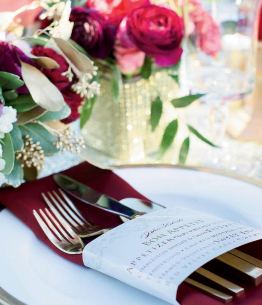 Menus by Signatures by Sarah. Flatware and charger from EventWorks. Napkins from Wildflower Linen. Florals by Larger Than Life Events. Image by Aneris Photography.