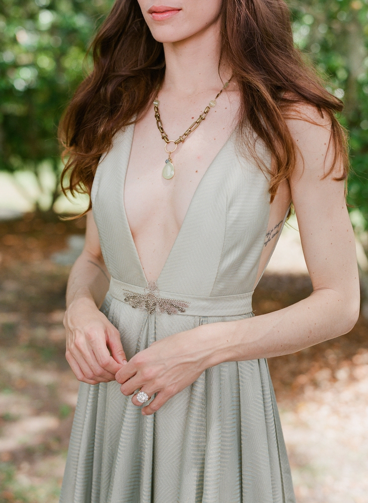 """Carol Hannah's """"Azurite"""" aqua and gold gown from Southern Protocol Boutique. Heather Key Tiller's chalcedony, calcite, and prehnite gold necklace from Filigree."""