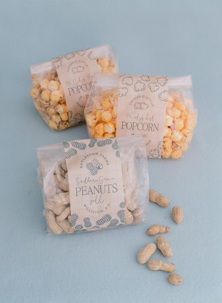 Favors included peanuts from the groom's family farm and Rewined candles, bought in bulk at the local brand's annual warehouse sale. Bridesmaids were gifted candles with custom labels.