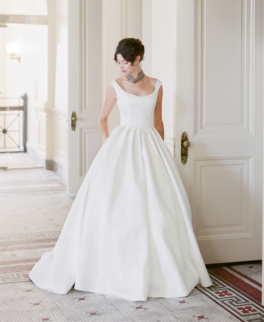 "Modern Trousseau's ""Gala"" Italian silk satin ball gown with embossed floral motif, available at Modern Trousseau flagship stores in Charleston, Nashville, Louisville, and Savannah.  Millianna's ""Andromeda"" collar from Gwynn's of Mount Pleasant. (Photo by Corbin Gurkin)"