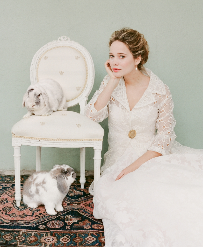 "Jim Hjelm's 8556 silk organza gown with floral print and detachable watteau train from Gown Boutique of Charleston. Ottod'Ame's ""Anna"" eyelet jacket from Out of Hand. Stylist's antique cameo pin. Diamond and pearl earrings from Roberto Coin."