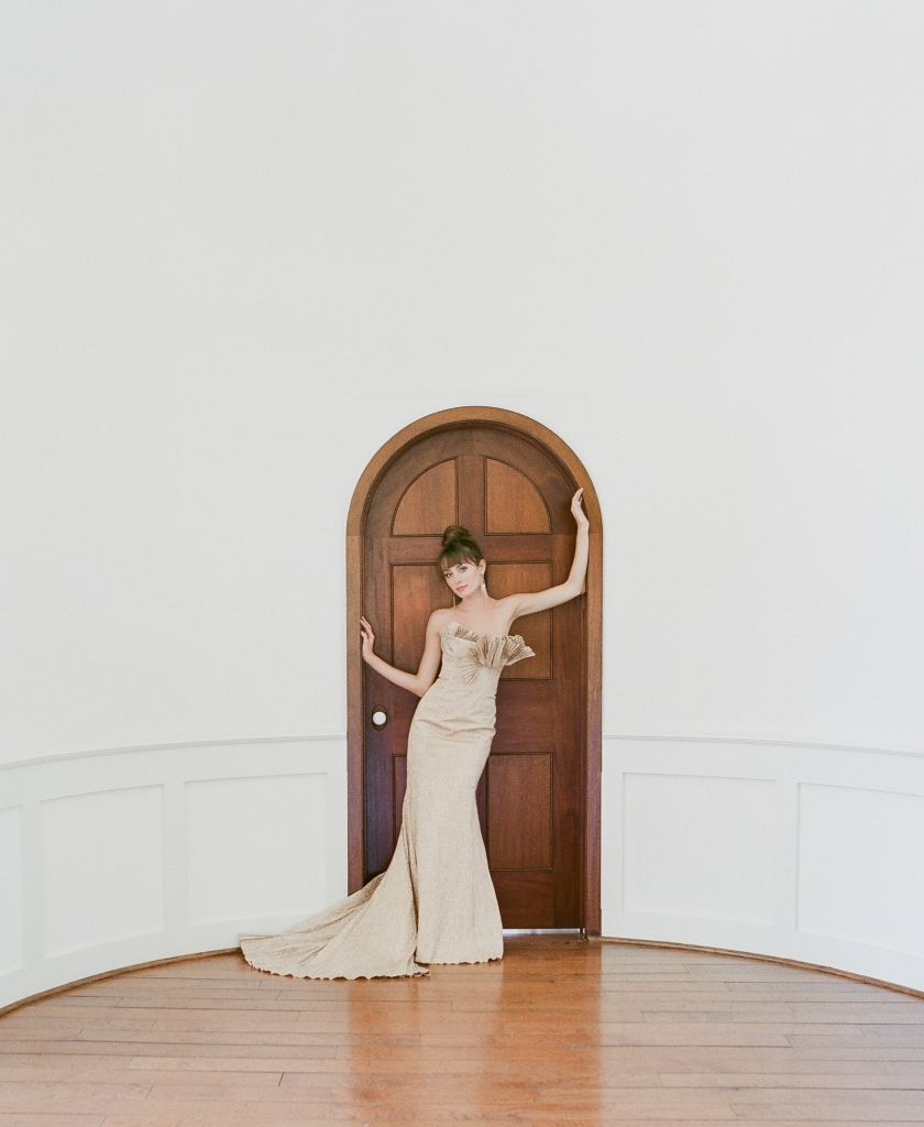 "Carol Hannah's  ""Narcisseae"" rose gold  metallic trumpet gown with pleated train and  bust from Southern  Protocol Bridal.  <i>Photograph Corbin Gurkin</i>"