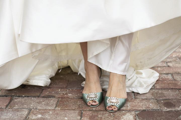 TWINKLE TOES: The reception's mint green theme popped up on Brianna's Badgley Mischka heels.