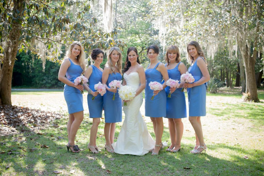 """BEST DRESSED: """"I loved how the soft pink shades of flowers popped against the dusty blue dresses,"""" says D'Anne of the bridesmaids' attire."""