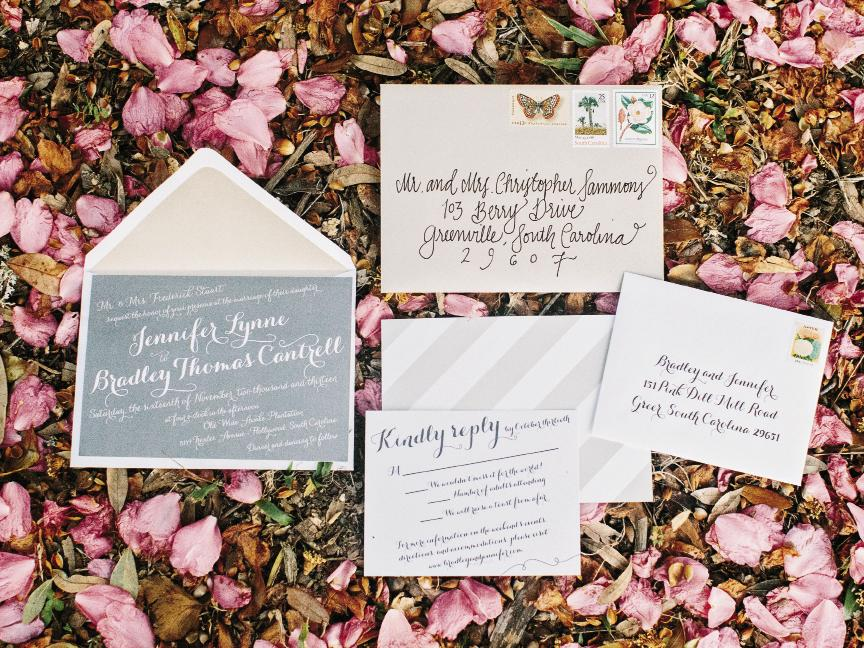 Jennifer played with orientation and contrast in the printed materials she drafted on  Wedding Paper Divas and printed with Vistaprint. Vintage stamps procured on eBay and envelopes addressed by a calligrapher finished the look.