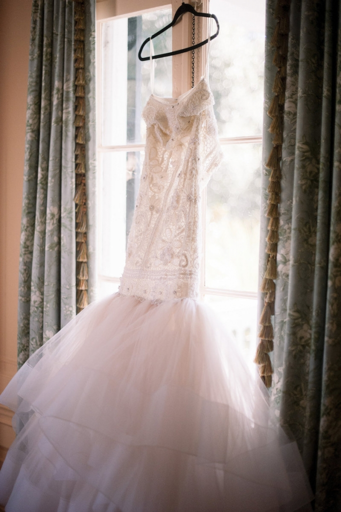 Bride's gown by Lazaro (available locally at Gown Boutique of Charleston). Image by Timwill Photography.