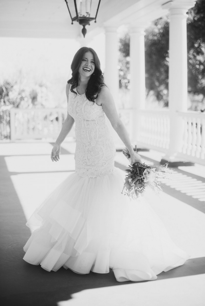 Bride's gown by Lazaro (available locally at Gown Boutique of Charleston). Hair by Updo Charleston. Makeup by MakeUp. Florals by Stems Floral Design by Jonie Larosee. Image by Timwill Photography at Lowndes Grove Plantation.