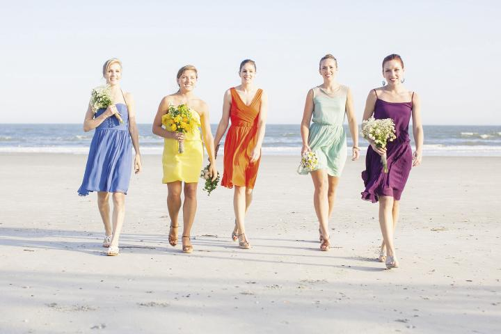 Colorful WOmen: Bridesmaids were assigned a color and picked their own dresses and accessories