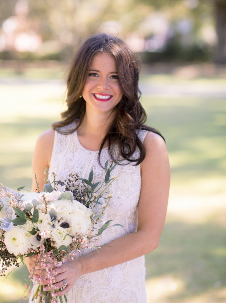 Bride's gown by Lazaro (available locally at Gown Boutique of Charleston). Hair by Updo Charleston. Makeup by MakeUp. Florals by Stems Floral Design by Jonie Larosee. Image by Timwill Photography.