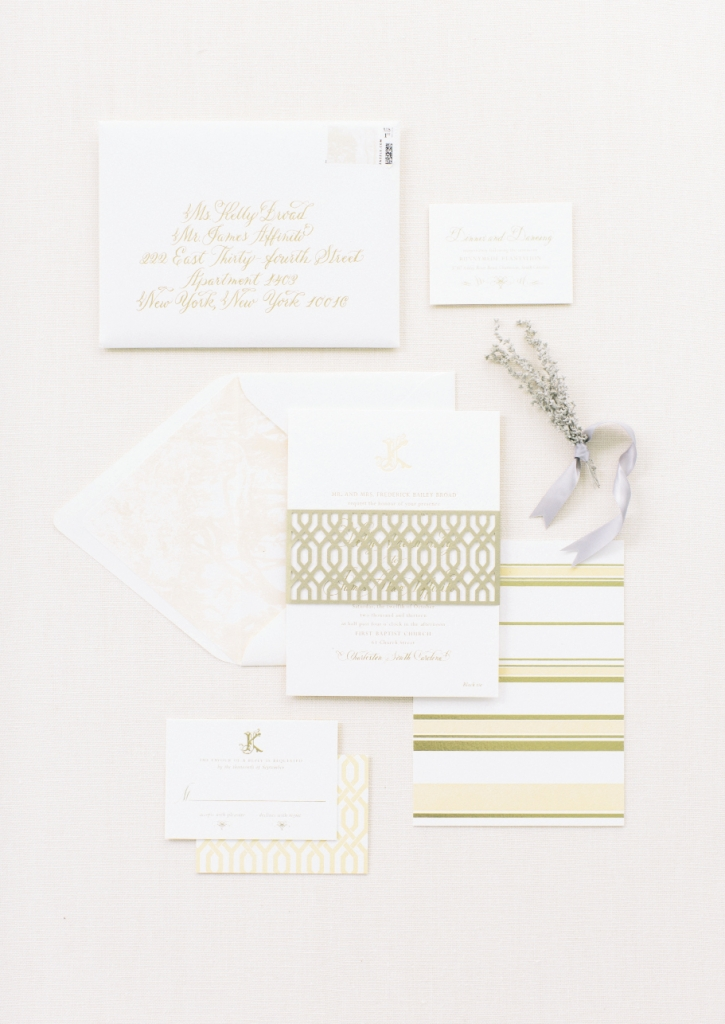 Lettered Olive fashioned a stationery suite in peaches, creams, and pale green to complement the reception landscape and wedding florals. A standout? The laser-cut belly band on the invitation.