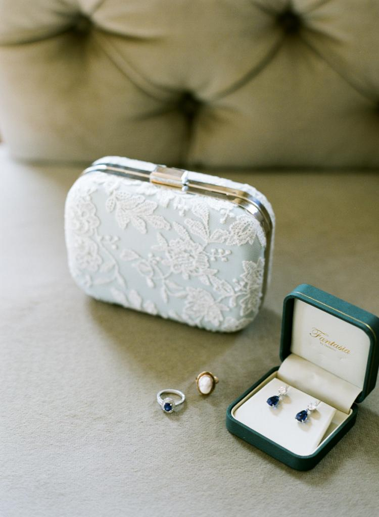 SOMETHING BLUE: The bride's father had given her a pair of blue sapphire earrings for her birthday, which she wore along with her blue sapphire engagement ring custom made by Matthew and Laurie Sarah Designs (found on Etsy).