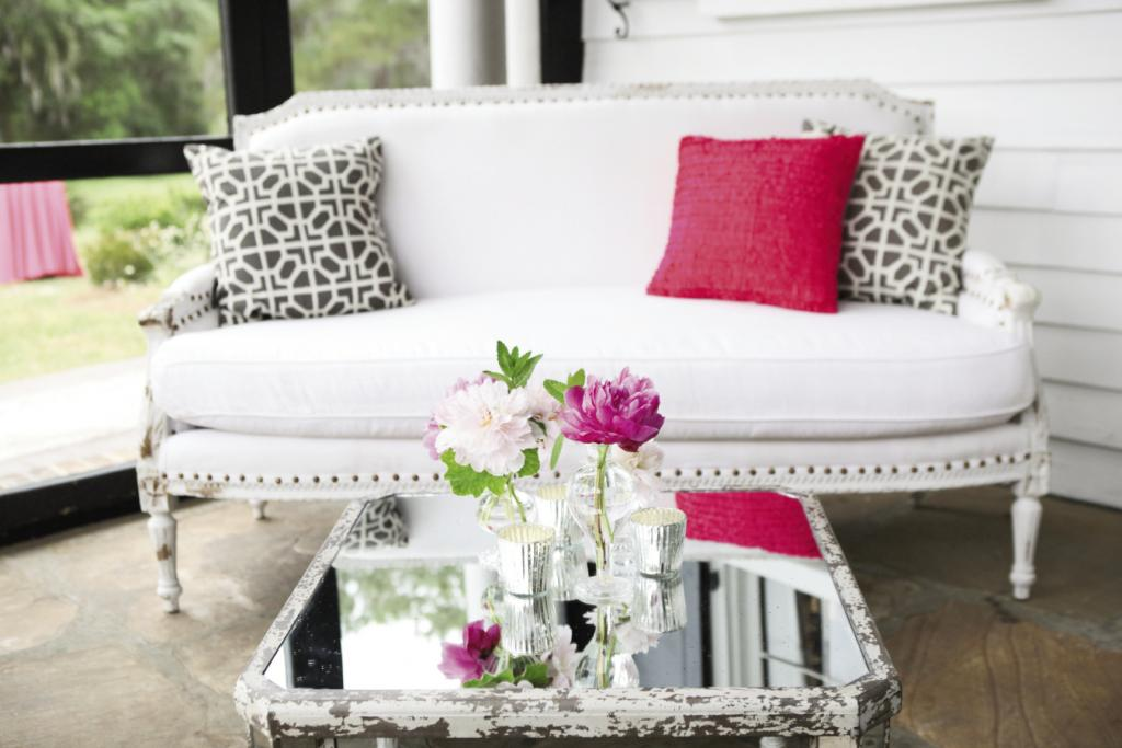 """BIG IMPACT: A single pink pillow brought a fun, energetic punch to an otherwise formal sitting area. """"Luke added little splashes of bright pink in certain places that really drew your eye,"""" the bride says."""
