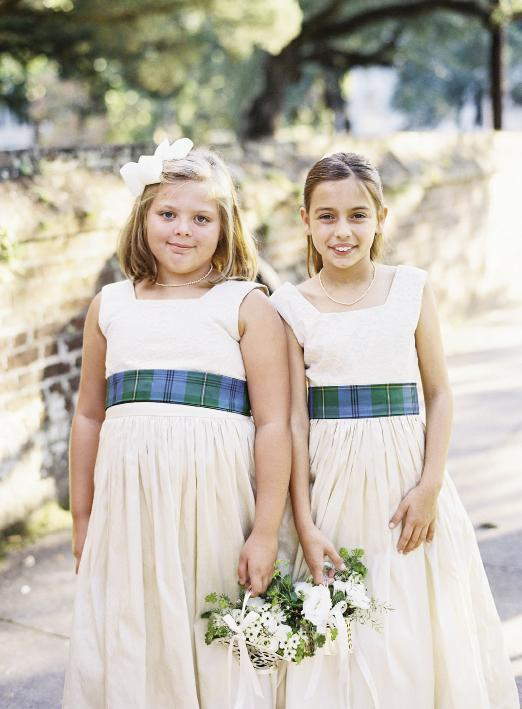 Flower girls wore the bride's family tartan as sashes.  Florals by Blossoms Events. Photograph by Tec Petaja.