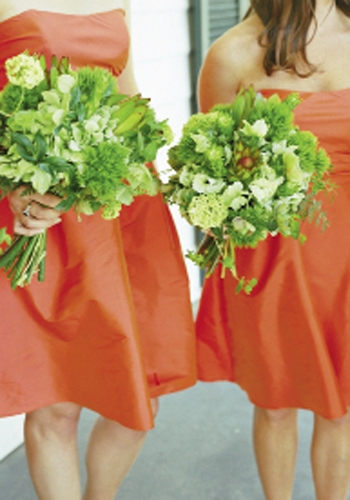 ORANGE CRUSH: Bridesmaids donned bright frocks by Jim Hjelm and held springy bouquets of bupleurum, green trick, helleborus, hydrangea, leucadendron, and viburnum.